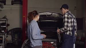 automotive repair complaints cute car or automotive technician wearing work robe and a cap writes