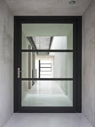 minimalist glass entry door with stylish framework