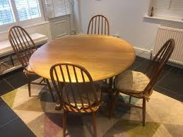pine circular dining table and 4 chairs ercol style quick hence