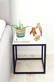 Tiny Size And Metal Foundation Plus Two Type Color For Building A Nightstand  And Cute Items On Top Part Beside Double Bed On Wooden Floor