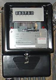 electricity meter three phase electromechanical induction meter metering 100 a 240 415 v supply horizontal aluminum rotor disc is visible in center of meter