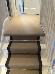 carpet runners for stairs. grey carpet with black border and golden stair rods to stairs runners for