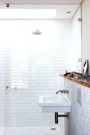 white bathroom tile ideas white tiled bathroom looks like beveled subway tile black and white floor