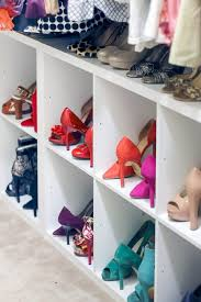 use storage cubes to add shoe storage in a shared master closet it s the perfect