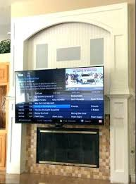 hang tv on wall mount to brick fireplace mounting above fireplace is the premier pull down