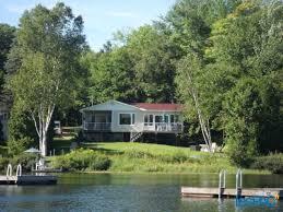 chalet maison à vendre bord de l eau lac à la perchaude st e mauricie usagé à vendre à st e le immobilier st e