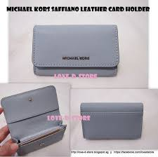 jet set travel saffiano leather card holder 75 inclusive of registered mail color dusty blue saffiano leather measures 4 5 l x 2 5 h