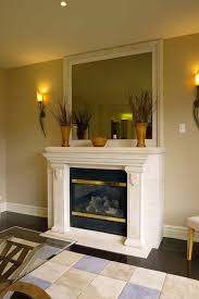 fireplace mantel decor the color scheme of three diffe sized vases on a white mantel