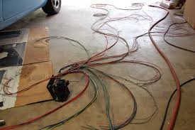 in our garage installing a new wiring harness daily painless harness laid out on floor