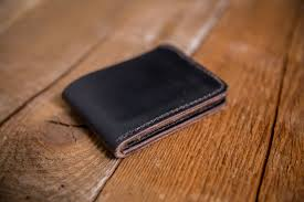 hand stitched horween leather bifold wallet in black chromexcel