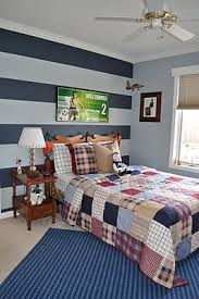 The Chic Technique: Northern Nesting: Striped Accent Wall.I've already  planned to do this in my boys room, even got the paint!