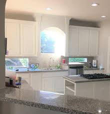 painting dark kitchen cabinets white