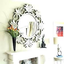 large mirror above fireplace over round mirrors extra