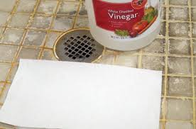 this tile shower floor has nasty hard water stains they can be cleaned easily with