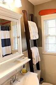 towel storage above toilet. This Ladder Towel Rack Over The Toilet Was Used For Storage And Visual Height Above A
