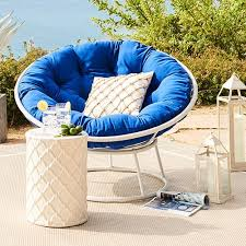 blue papasan cushion with white colored basket in an outdoor setting