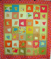 pieceful kwilter: wonky squares tutorial & #12. this is a quilt i made using a 'layer cake' (a stack of precut 10