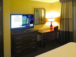 bedroom with tv and desk. Embassy Suites By Hilton Dulles Airport: Airport - Room 321 Chest Bedroom With Tv And Desk I