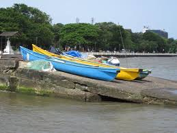 on the river beside the sea in goa a photo essay n ocean canoe boats and nets used by artisanal fishers on the mandovi river stationed at
