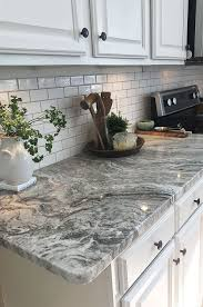 white cabinets paired with viscount white granite work surfaces