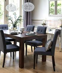 dark dining room table with light chairs