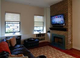 tv next to fireplace over gas fireplace how to mount over fireplace and hide wires next