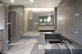 stock photo large modern bathroom with mosaic tile bathtub