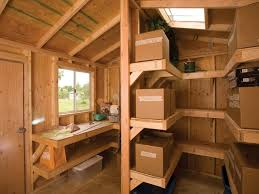 interior shelving and workbench by tuff shed storage buildings garages via flickr