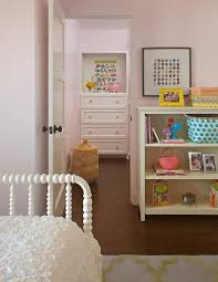 white and pink girl bedroom with white jenny lind bed and yellow trellis rug