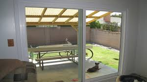 modern replacement sliding door with large glass screen and aluminum frame for access to home patio