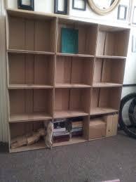 cardboard boxes used as art studio shelving