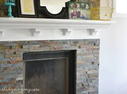 our diy fireplace installing the slate splite face tile the diy mommy