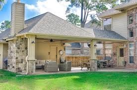 what more perfect time to also install a luxurious covered patio and outdoor fireplace the finished project features stunning wood ceilings natural stone