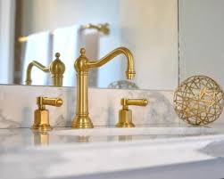 white bathroom interior design with excellent gold sink faucet using nice marble counter using chic frameless mirror