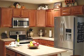 space above kitchen cabinets called black stove brown cabinet sets dark granite countertop built in stove