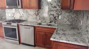 light color granite countertops kitchen countertop and backsplash with dark cabinets