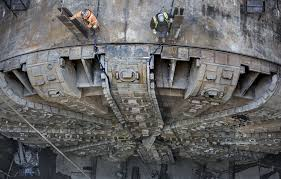 the end is near for bertha after nearly 2 miles in 4 years workers stand on top of the tunnel boring machine bertha looking down at the