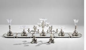 twelve piece egyptian revival silver plate and cut glass surtout de table service