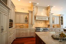 Excellent Oak Wood Cabinets Flanking Classic Copper Hood Material With  Subway Tiles Ideas For Kitchen Interior Design .