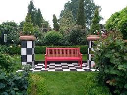 alice in wonderland garden court gardens in wonderland bench alice in wonderland garden figures uk