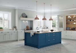 kitchen brown pendant lights blue wooden island gray pattern rug gray floor white wooden cabinet remodel