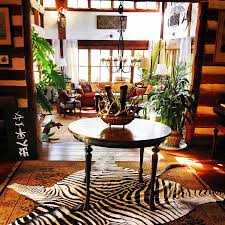 view in gallery zebra hide rug gives the room an instant focal point