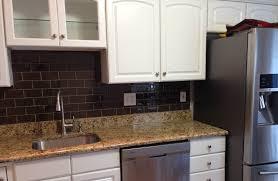 chocolate glass subway tile kitchen backsplash