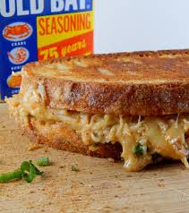 crab grilled cheese cooking is messy