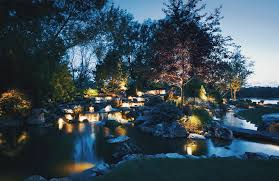 paradise landscape lighting. a brilliant lighting scheme helps your yard transition smoothly from sunny daytime paradise to warm and welcoming nighttime oasis landscape