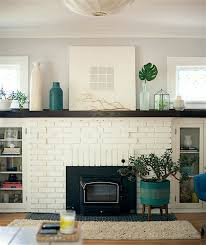 beautiful white painted brick fireplace