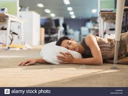 office sleeping pillow. Businesswoman Sleeping With Pillow On Office Floor O