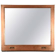 mirror window. copper window frame mirror from the mcalpin hotel 1
