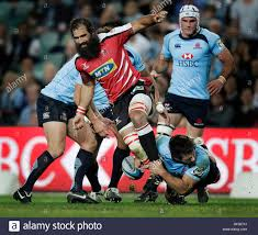 josh daniel where stock photos josh daniel where stock images josh strauss of south africa s lions is tackled by chris alcock of s waratahs during their