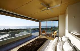 modern luxury beach houses interior that has wooden floor inside decor with queen size bed and also white pillows can add the beauty modern luxury beach house interior m77 interior